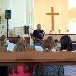 Pastor and children